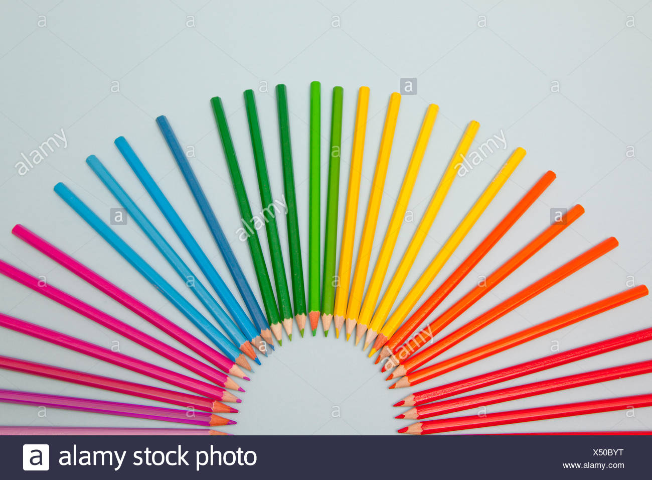Colored Pencils arranged in semi circle - Stock Image