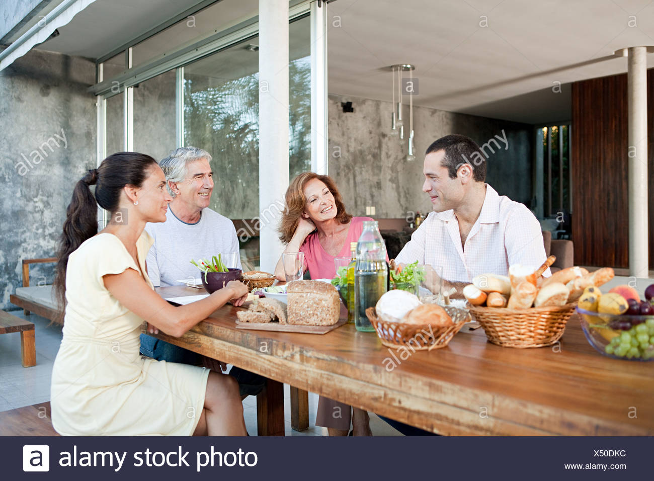 Adult family members at table outdoors Stock Photo