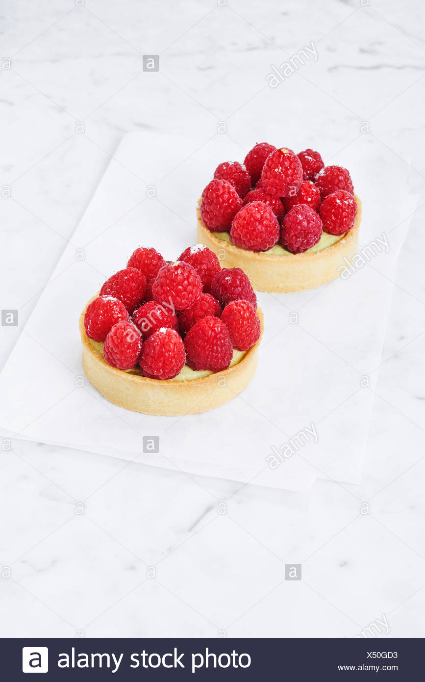 Two raspberry tarts, elevated view - Stock Image