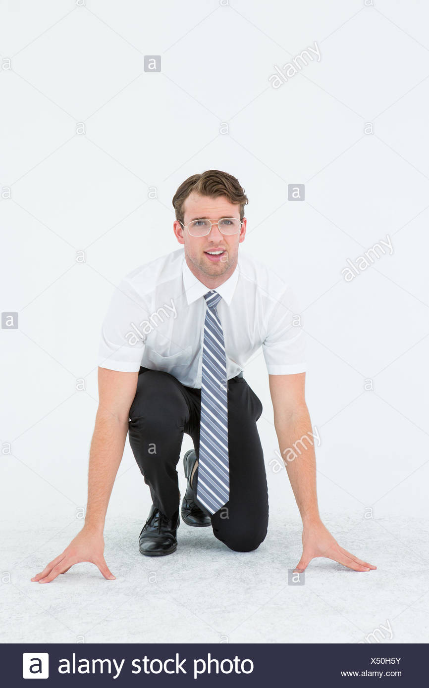 Geeky young businessman ready to race - Stock Image