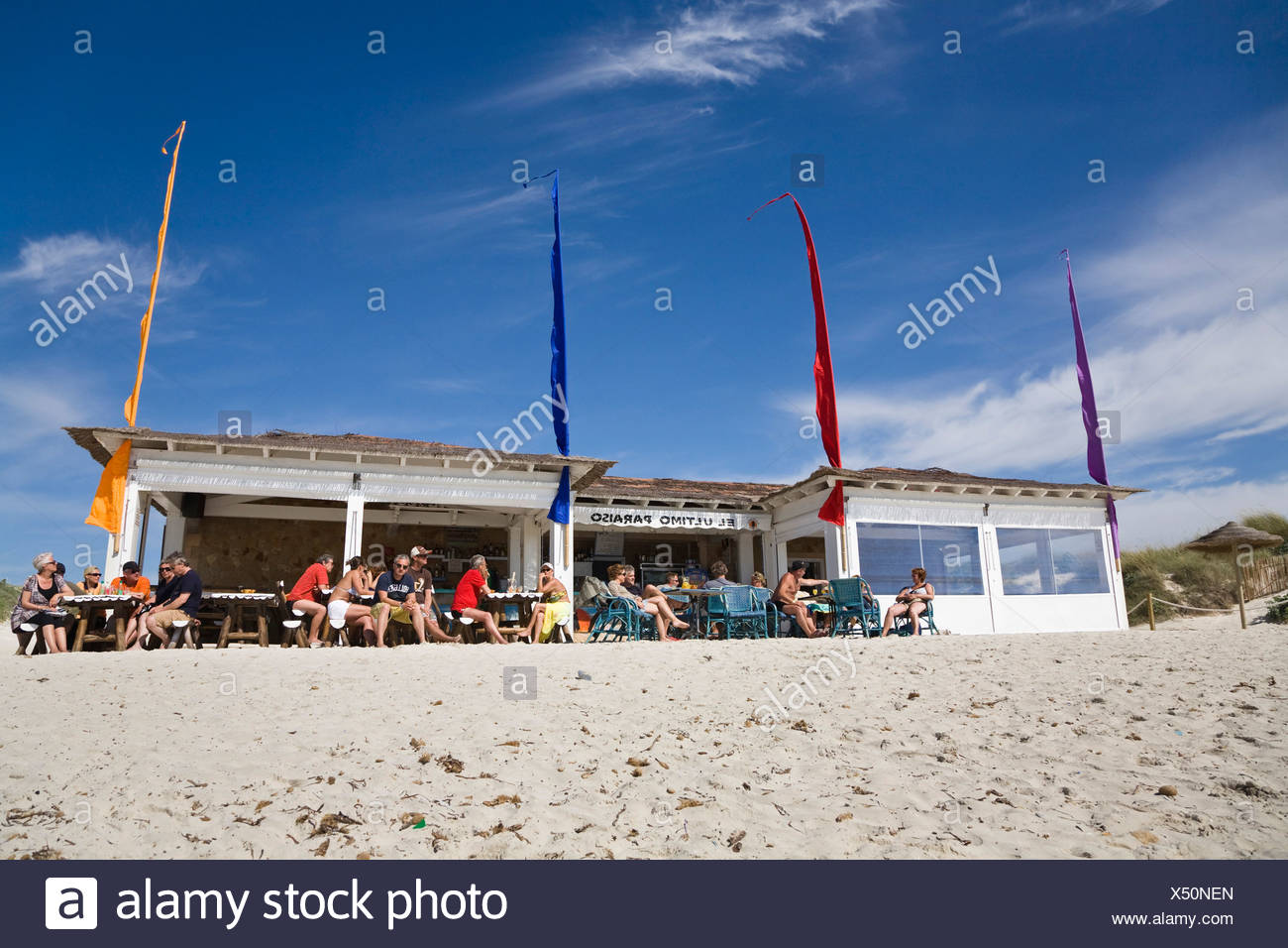 People siting in front of a beach bar at the beach of Es Trenc, Mallorca, Majorca, Balearic Islands, Spain, Europe - Stock Image