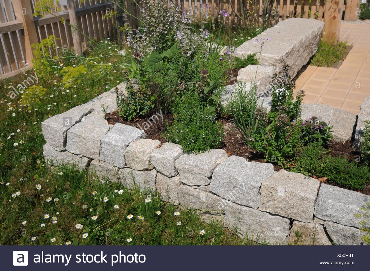 Raised bed made of granite stones Stock Photo