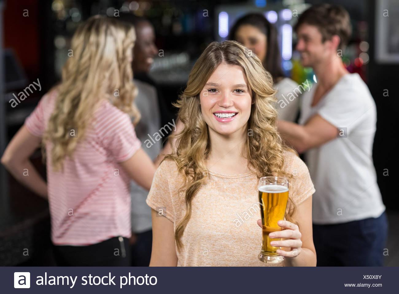Smiling friends having beers - Stock Image