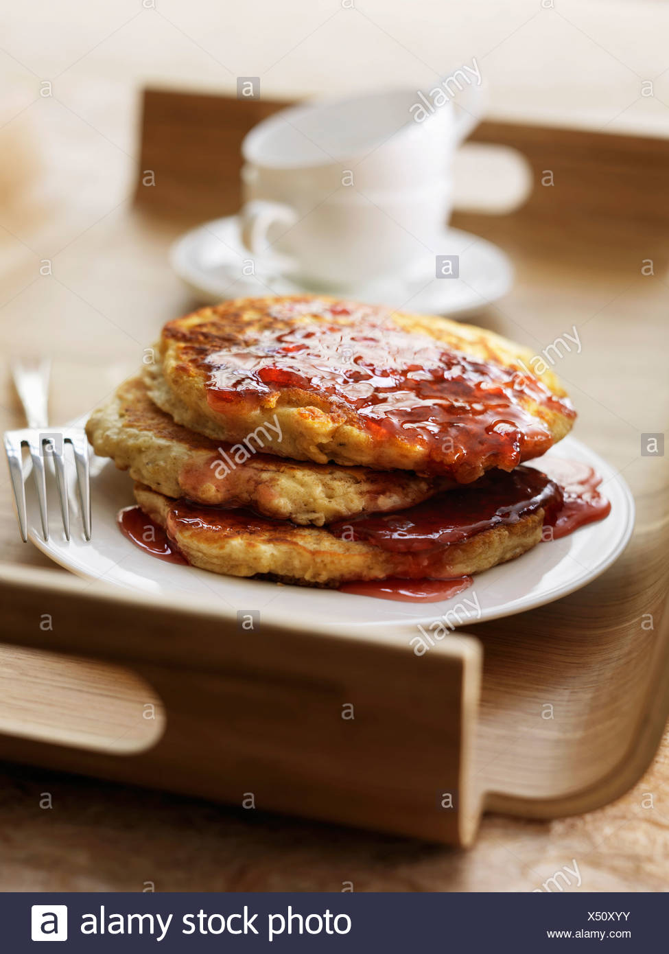Oat flake pancakes with maple syrup - Stock Image