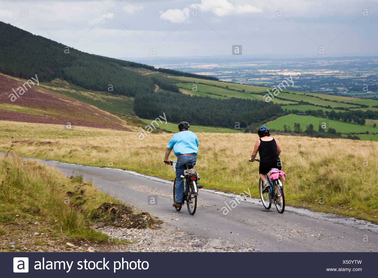 Republic of Ireland, County Carlow, Mount Leinster, people cycling on hilltop road - Stock Image