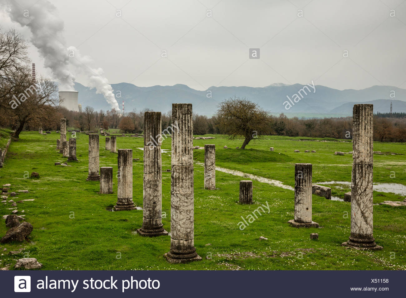 Ancient Greek ruins near a power plant. - Stock Image