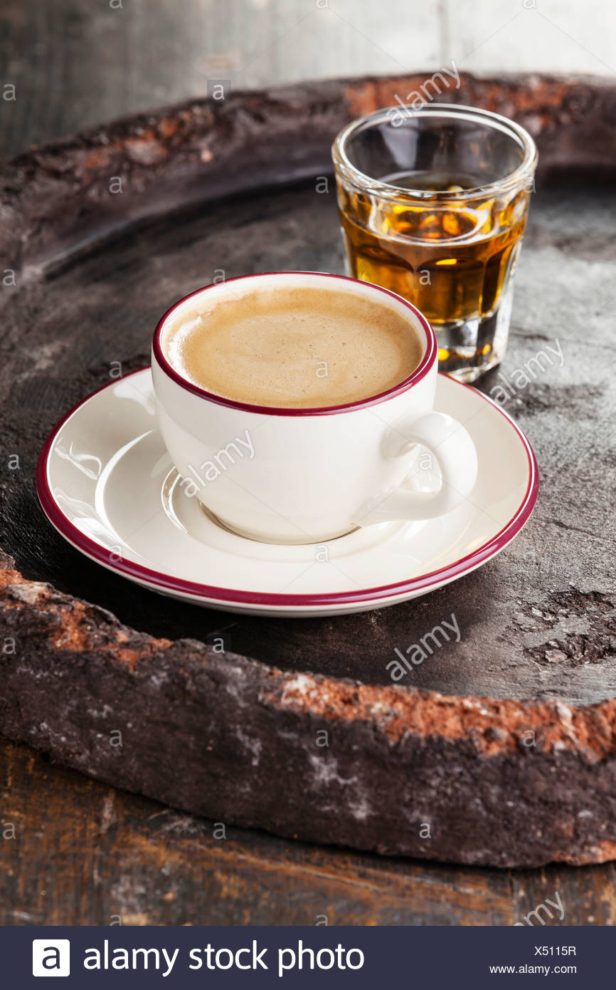 Coffee laced with brandy on dark background Stock Photo