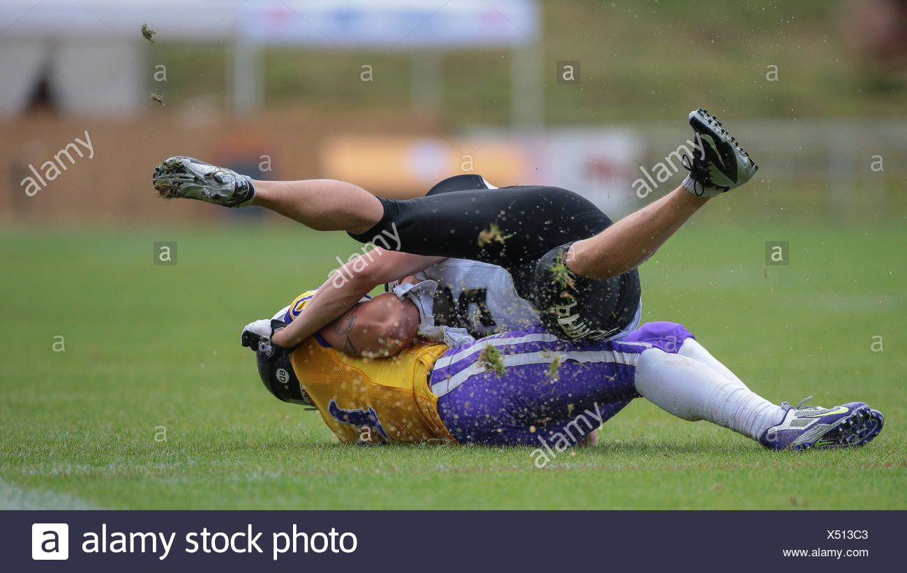 TE Manuel Thaller, No. 11 Vikings, tackles WR Jakub Wolesky, No. 2 Panthers, during an Austrian Football League game - Stock Image