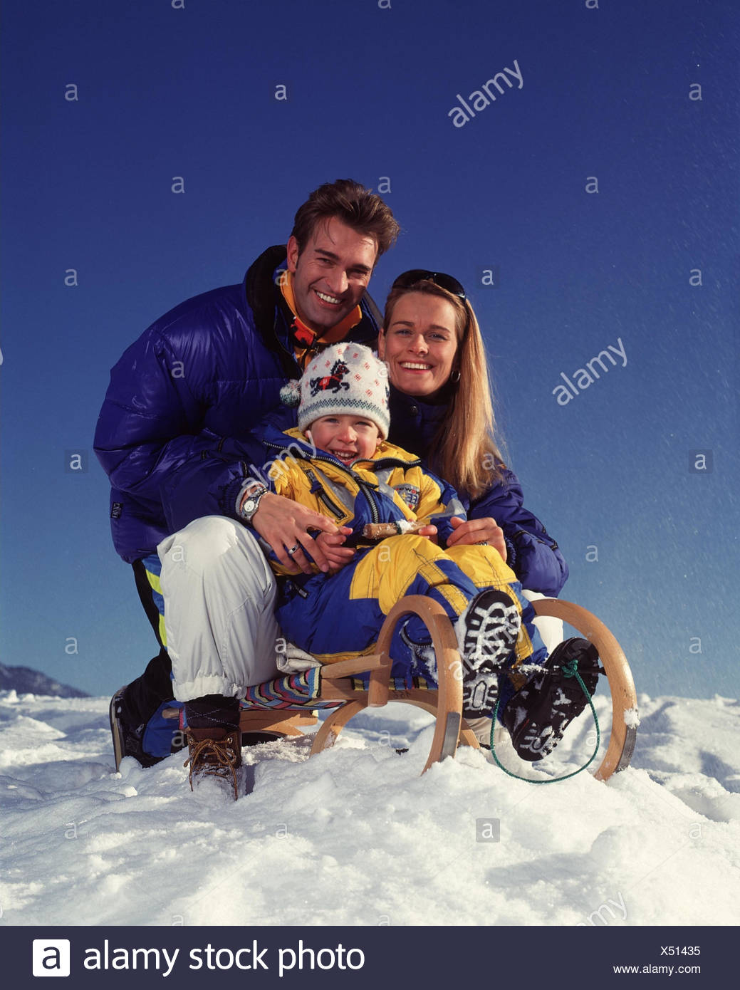winters parents infant happy sleigh riding winter vacation