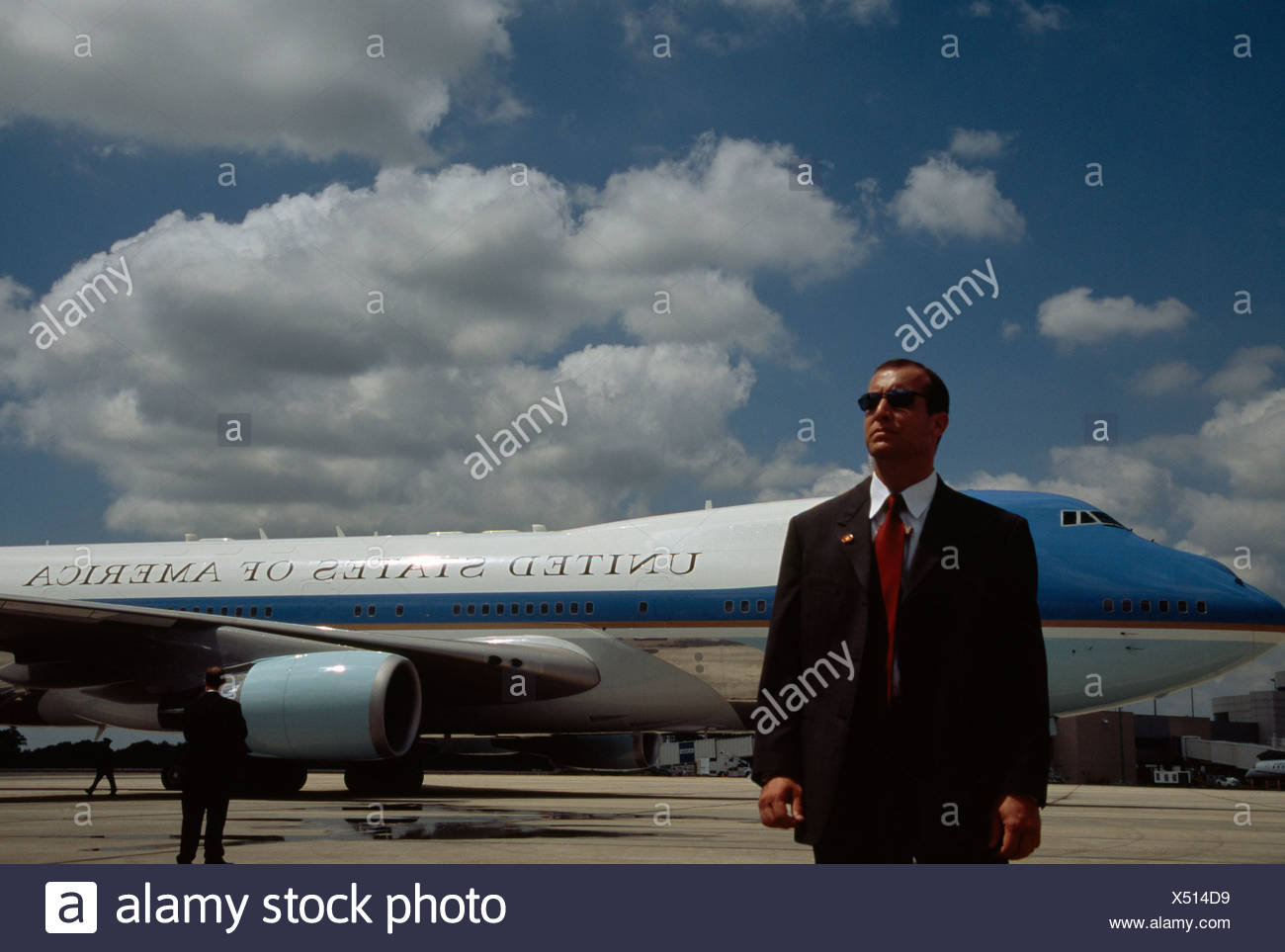 A Secret Service agent stands guard in front of Air Force One. - Stock Image