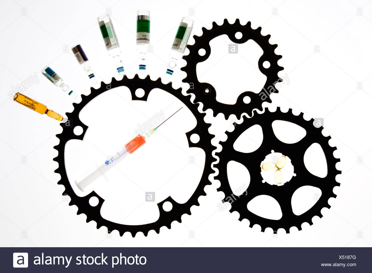 Gear wheels and medicines symbolize medicine abuse (doping) in the cycling. - Stock Image