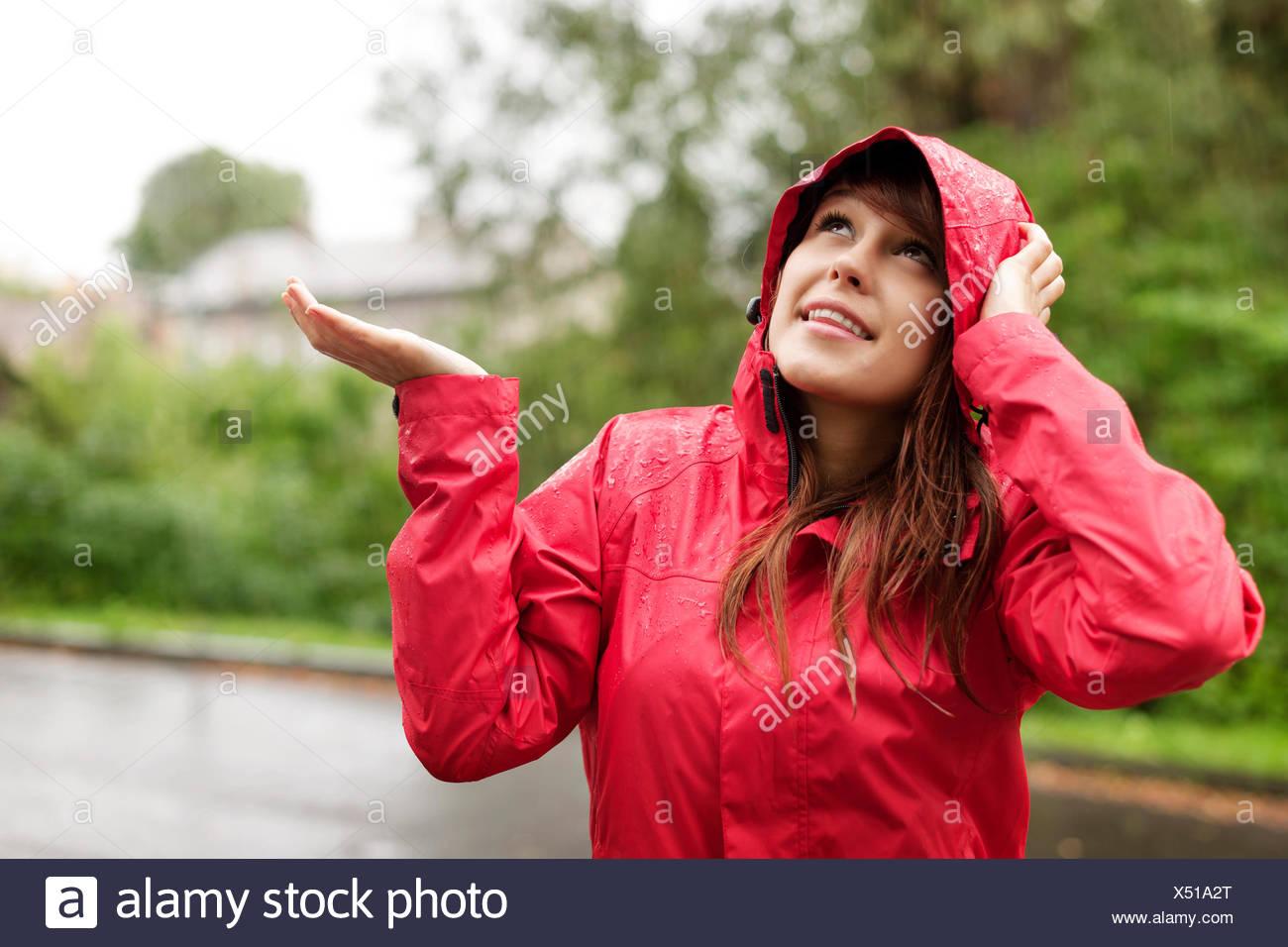 f7f94d4ef Beautiful woman in raincoat checking for rain, Debica, Poland Stock ...