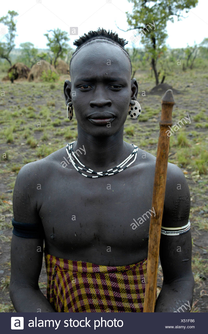 Portrait of the chief of the Mursi tribe, holding a lance, near Jinka, Ethiopia, Africa - Stock Image