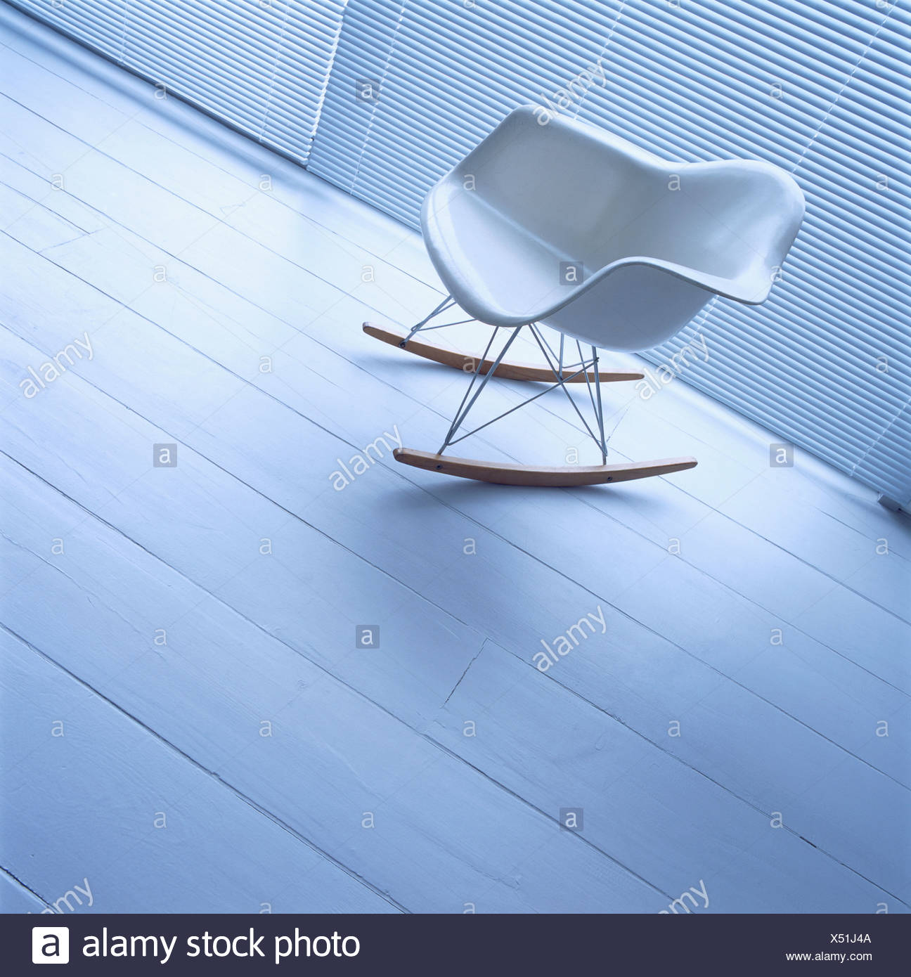 Close Up Of White Charles Eames Rocking Chair On Wooden Flooring   Stock  Image