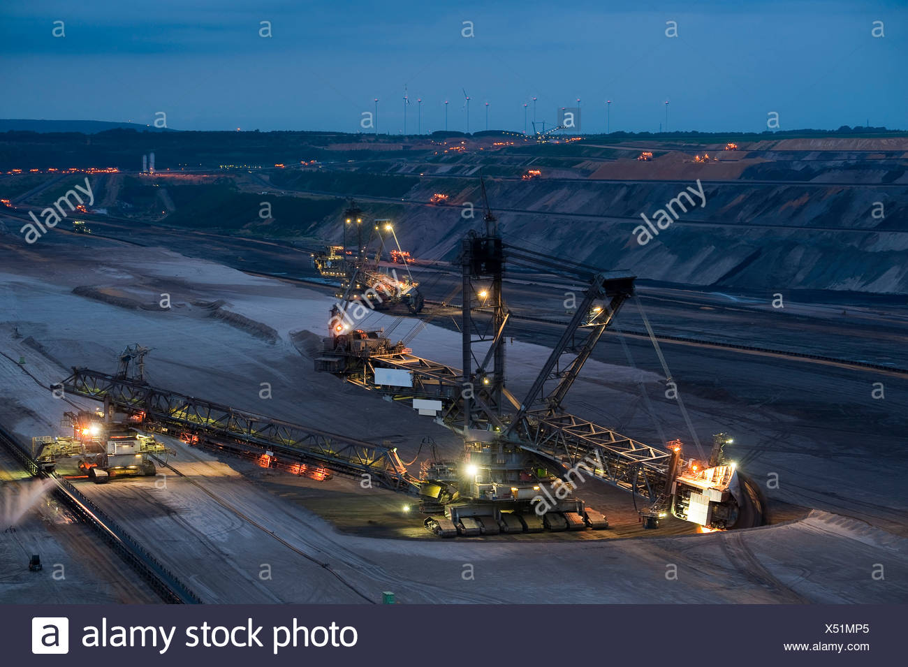 Bucket-wheel excavator at the blue hour in an open pit, Grevenbroich, North Rhine-Westphalia, Germany, Europe - Stock Image