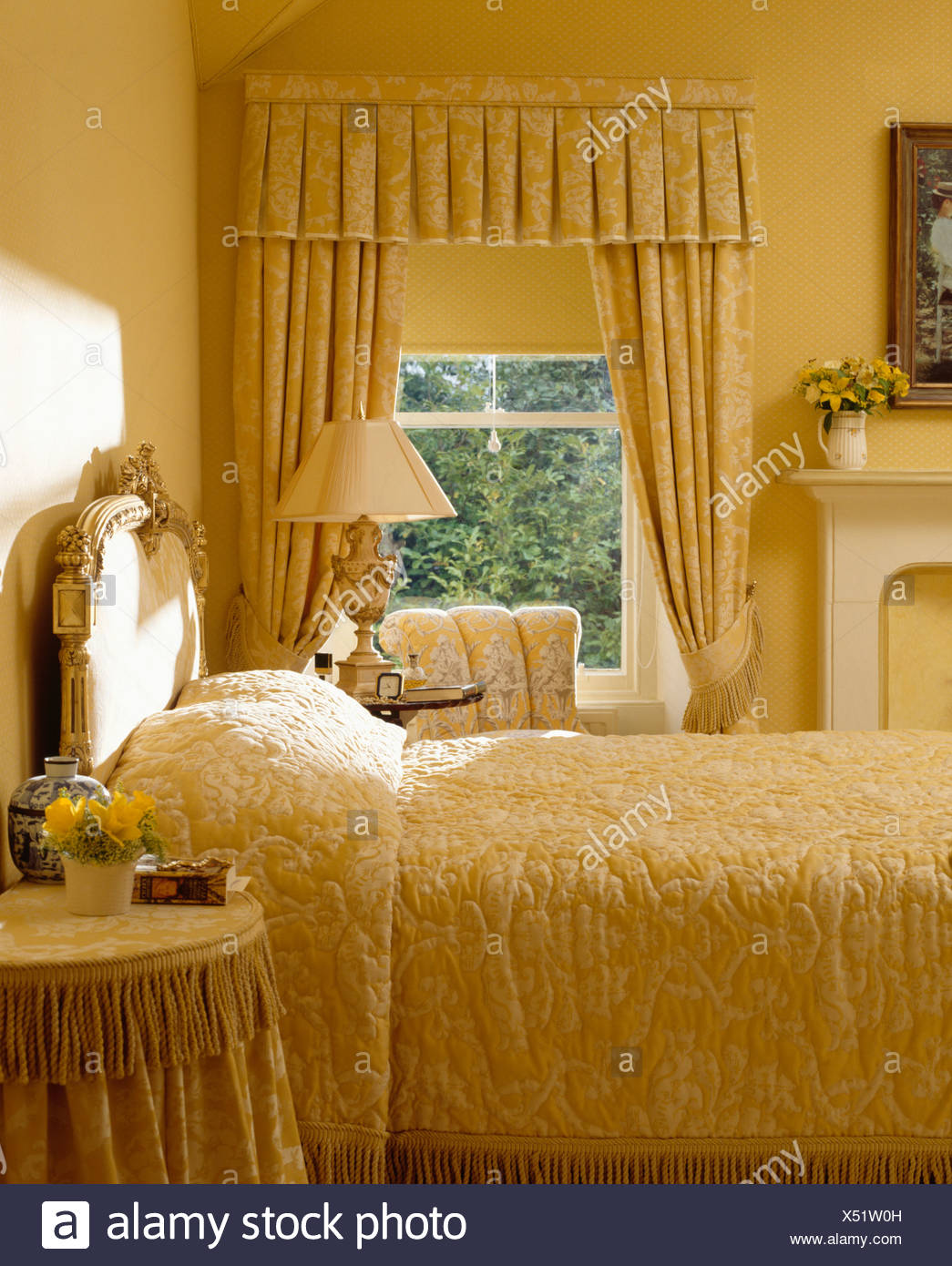 Pastel Yellow Bedroom With Quilt And Matching Drapes And Blind At