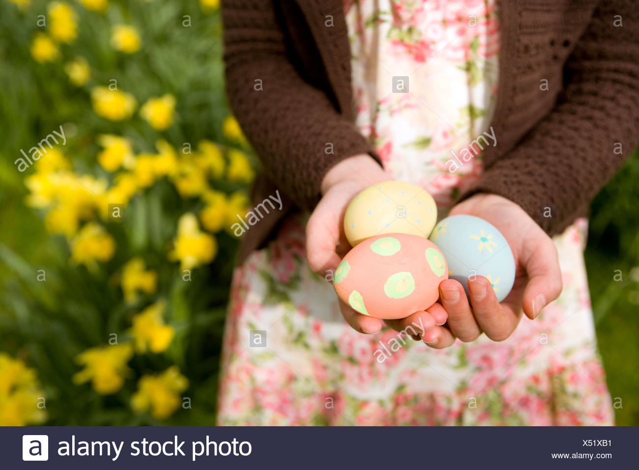 Young girl holding decorated Easter eggs - Stock Image