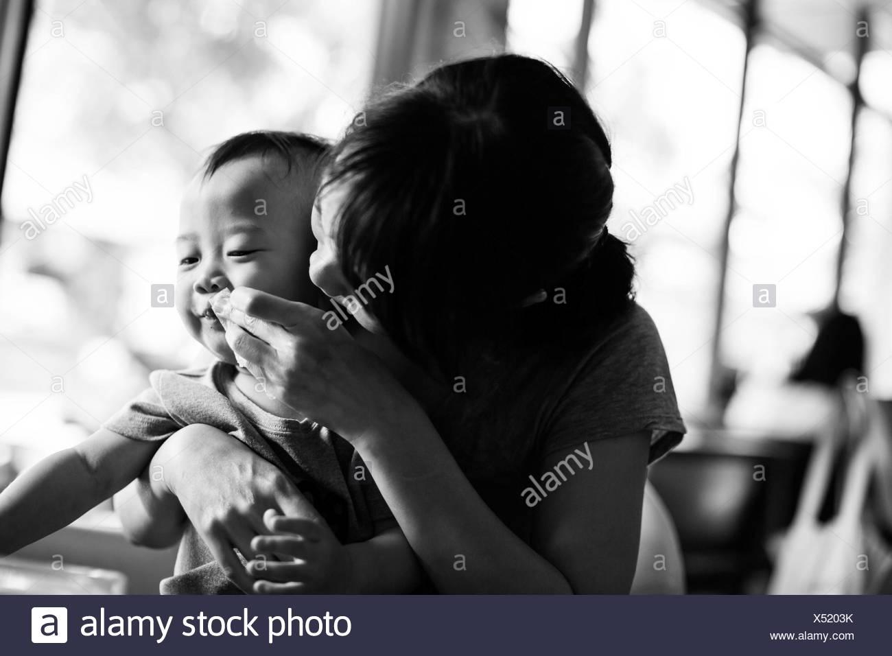 Mother feeding child - Stock Image