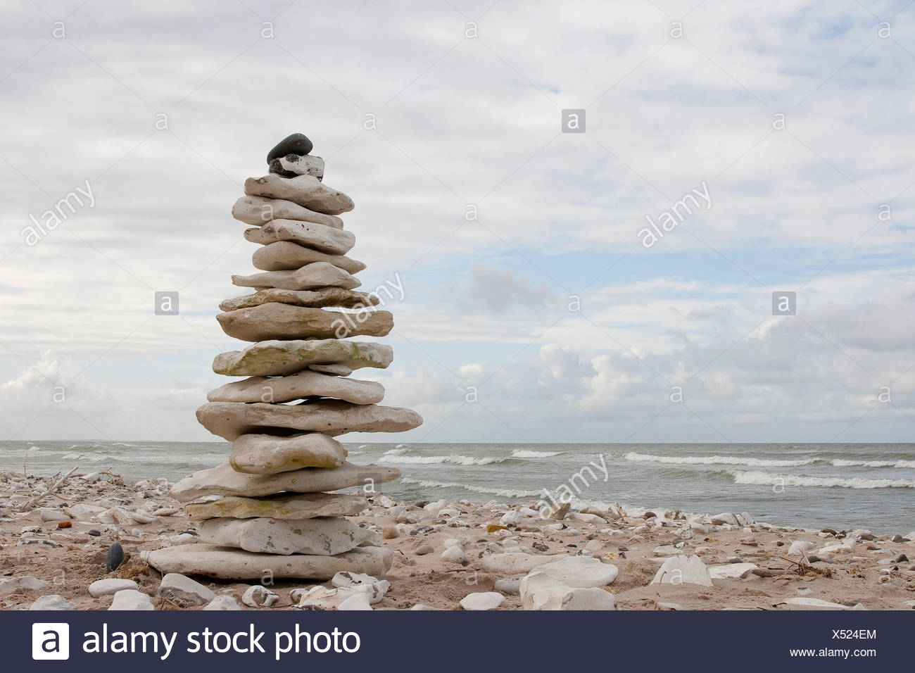 pile of stones on the beach, nature art, Germany - Stock Image