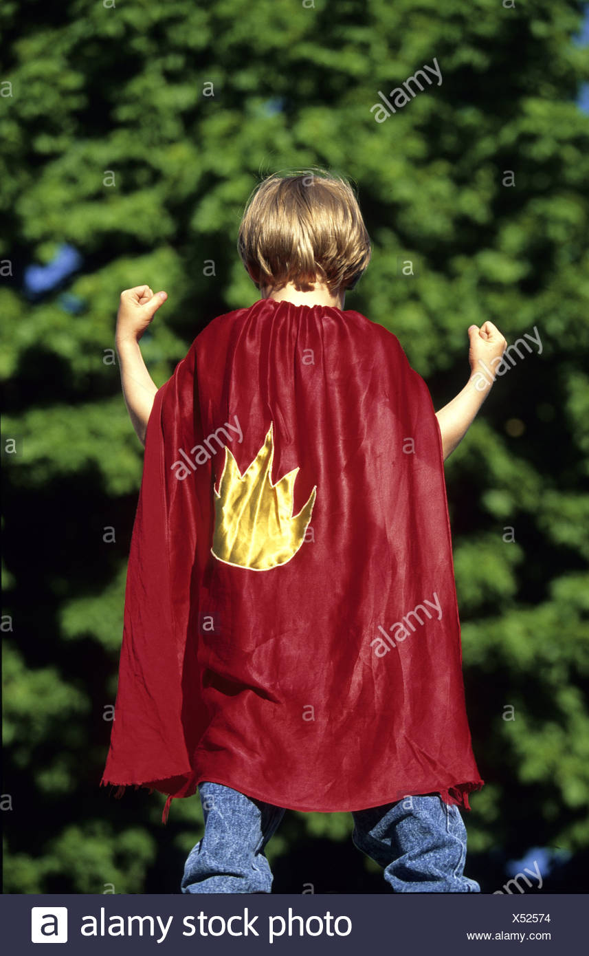 Rear view of a child wearing superhero cape and flexing