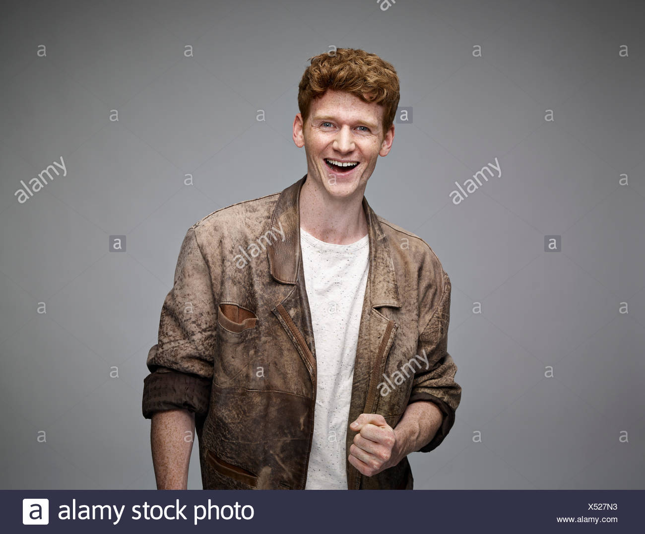 Portrait of laughing redheaded man - Stock Image