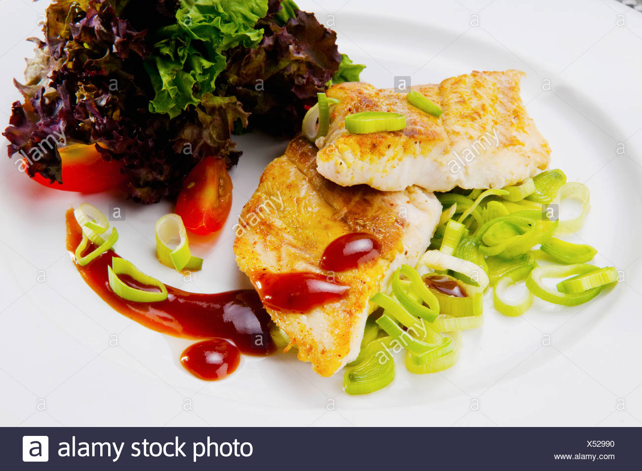 Close-up of a dish of fish fillets - Stock Image