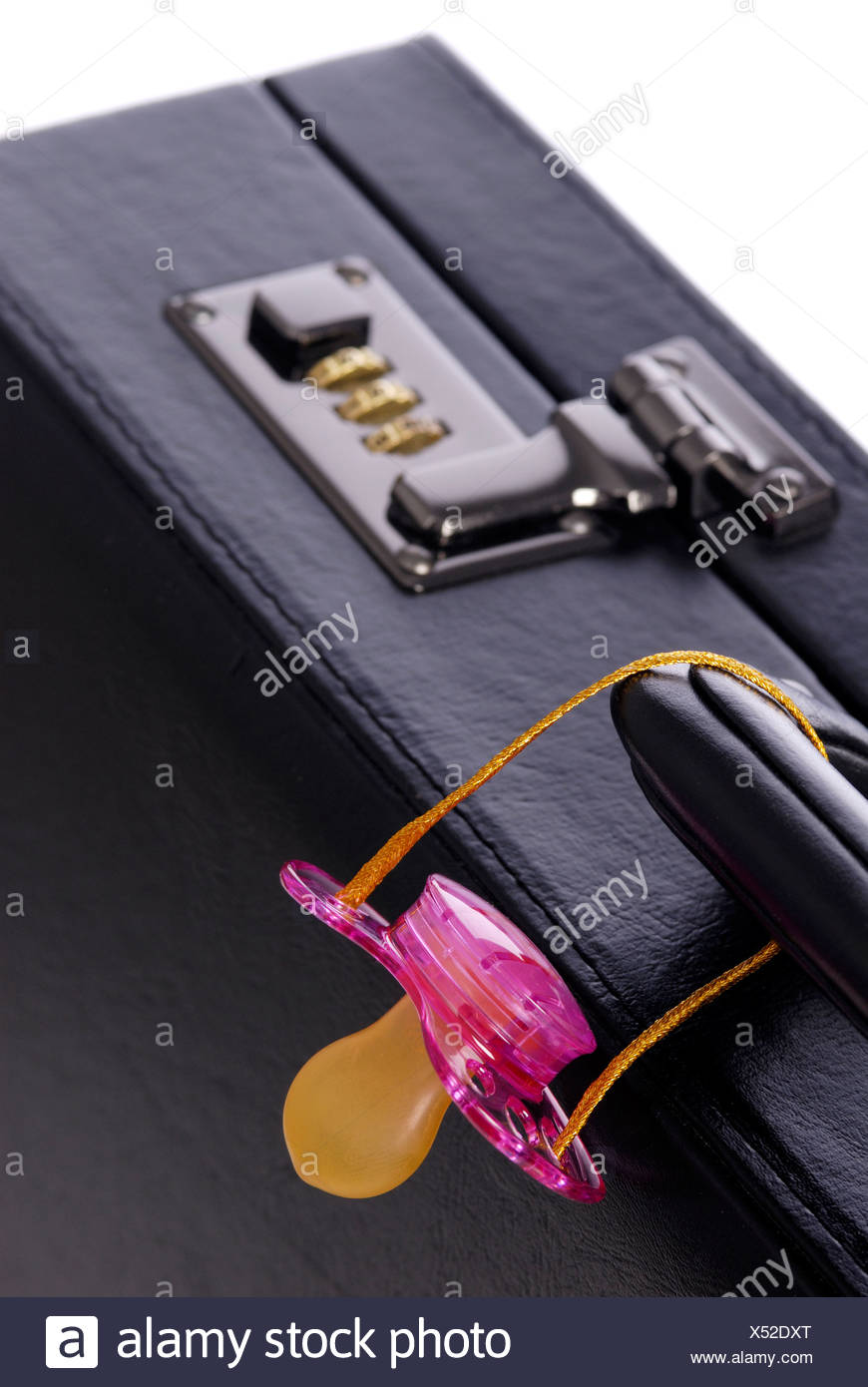 briefcase and a pink soother Stock Photo