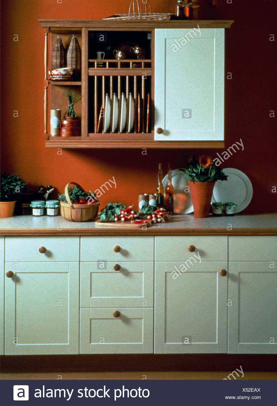 Plate rack and wooden shelves on wall unit in red kitchen with white fitted cupboards & Plate rack and wooden shelves on wall unit in red kitchen with white ...