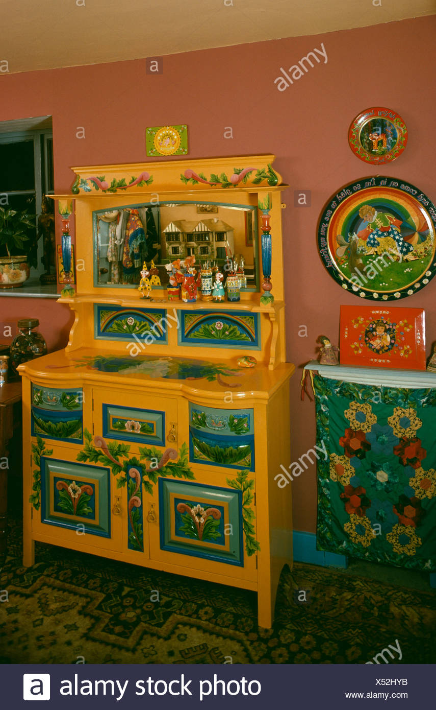 brightly painted furniture. Brightly Painted And Decorated Yellow Dresser In Sixties Dining Room - Stock Image Furniture