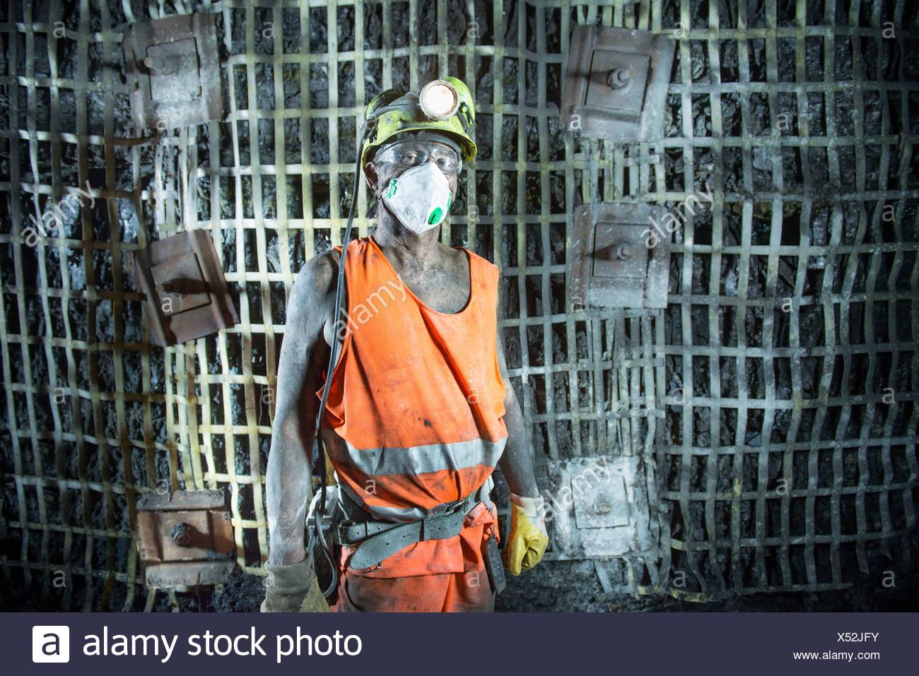 Coal miner standing in mine - Stock Image