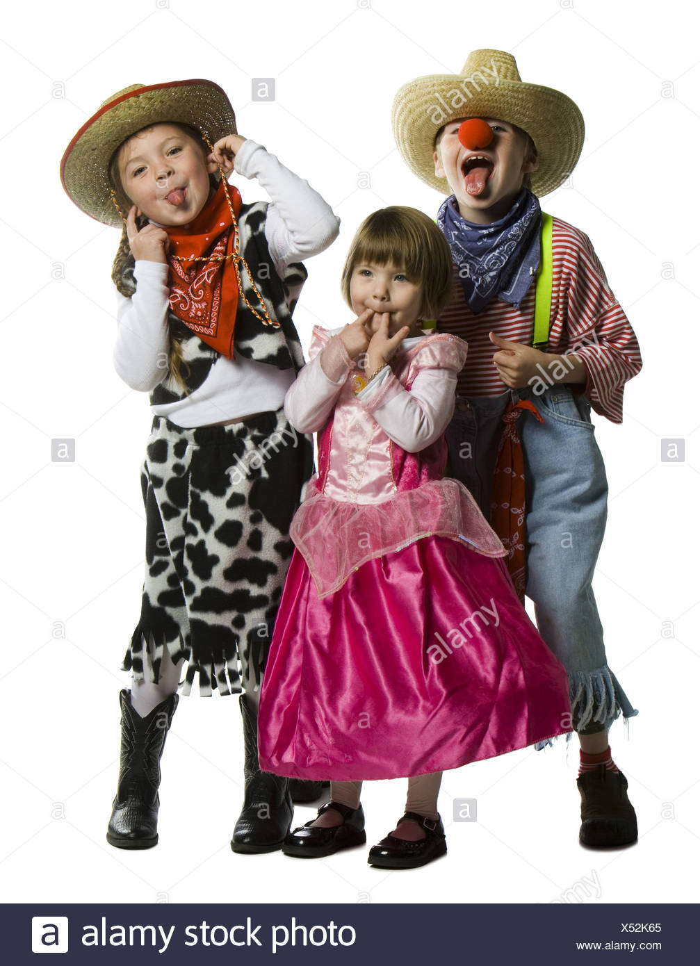 Two girls and a boy making faces in costumes Stock Photo