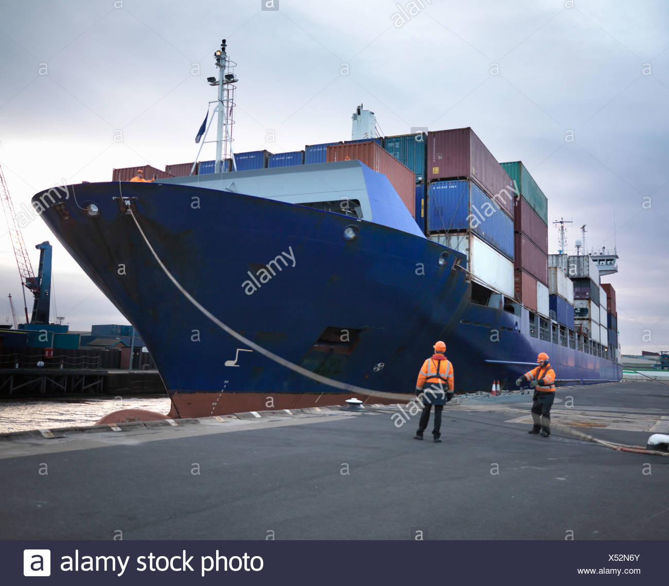 Port Workers With Loaded Ship At Port - Stock Image