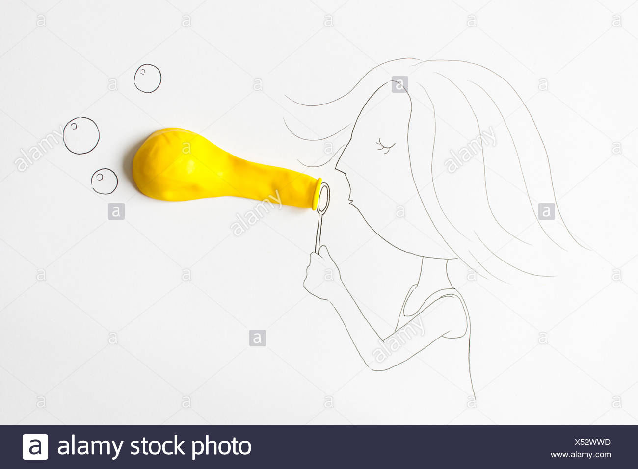 Conceptual girl blowing bubbles - Stock Image