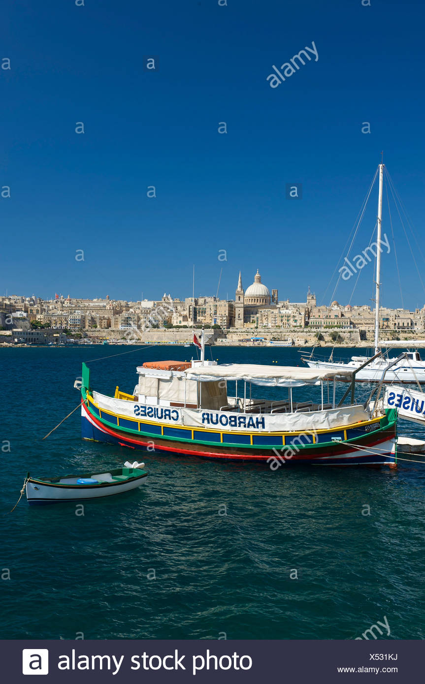 Excursion boats for harbor cruises with view from Sliema to Valletta, Malta, Europe - Stock Image