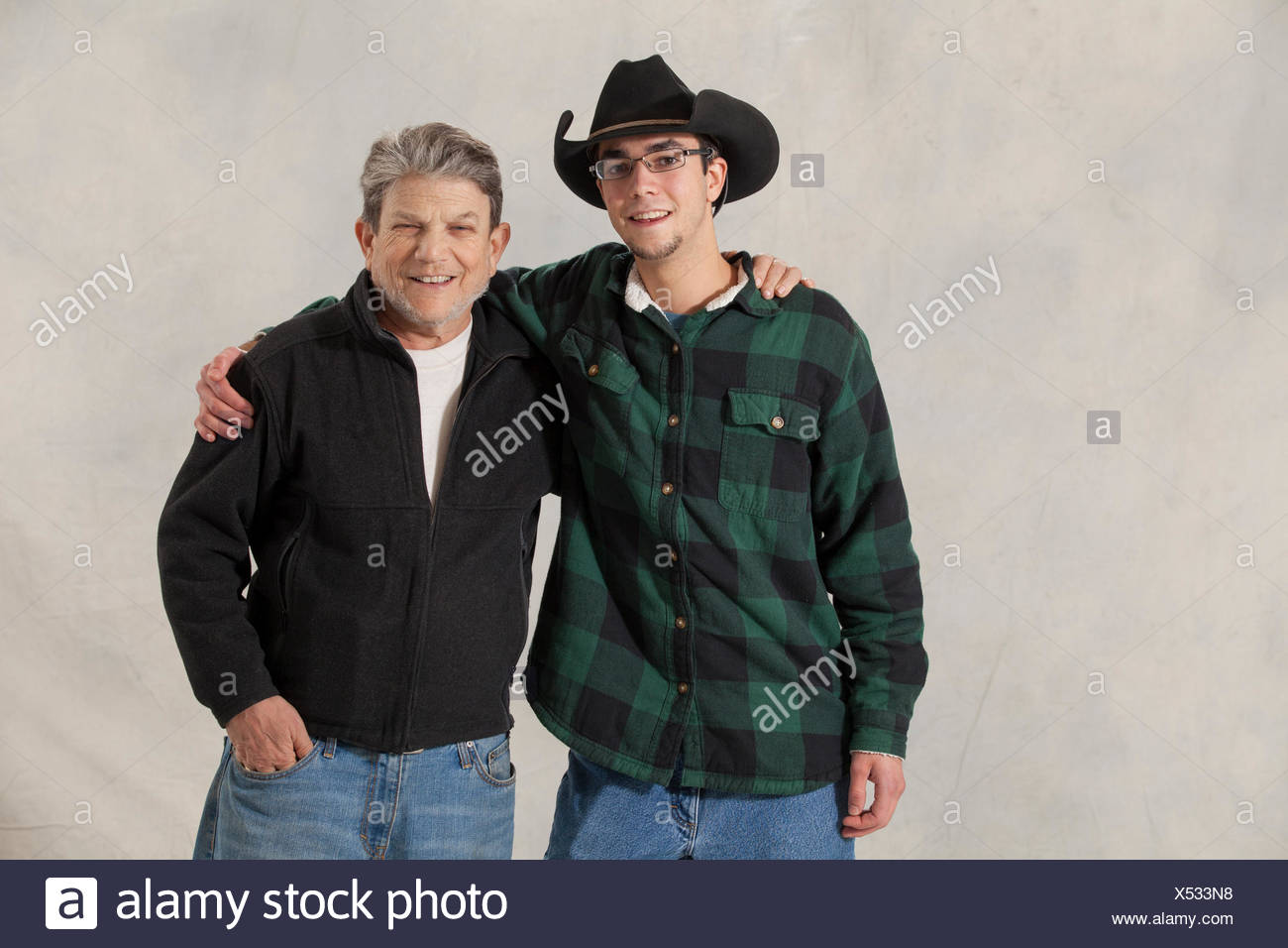 Portrait of a young man with autism and his mentor smiling - Stock Image