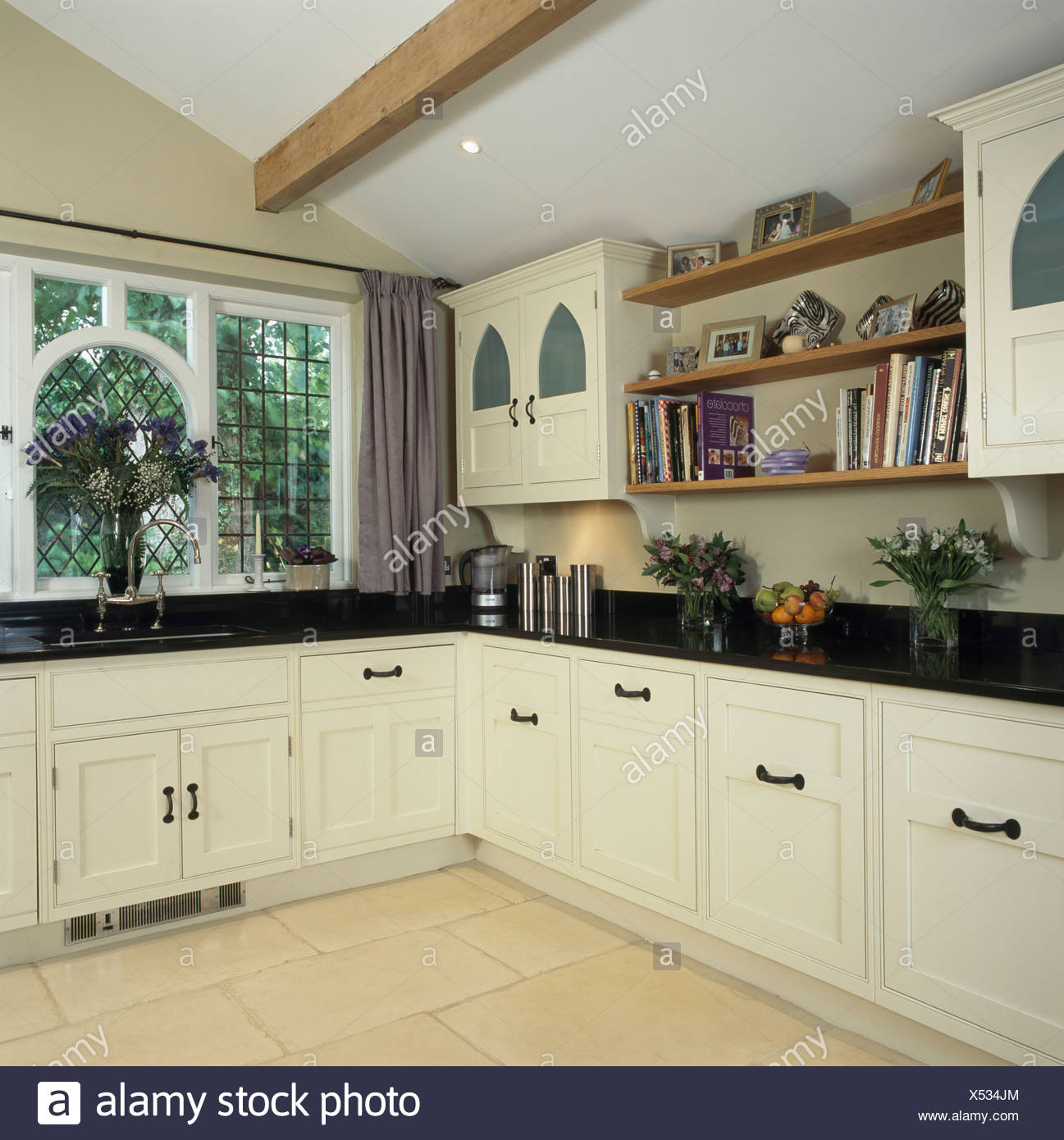 Traditional Kitchen Extension With White Cupboards And Black