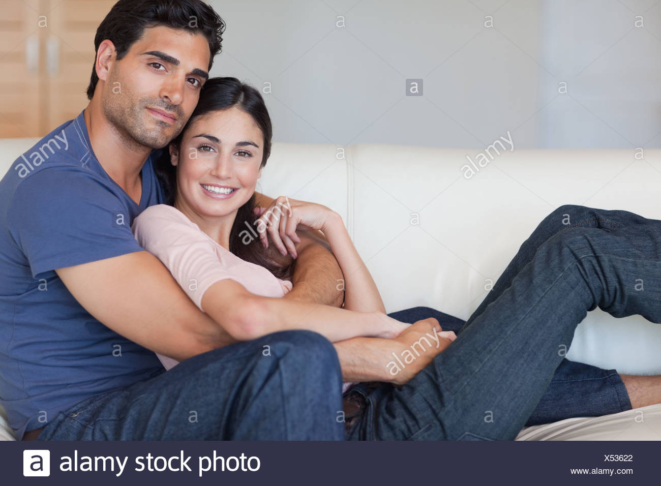 Lovely young couple posing - Stock Image