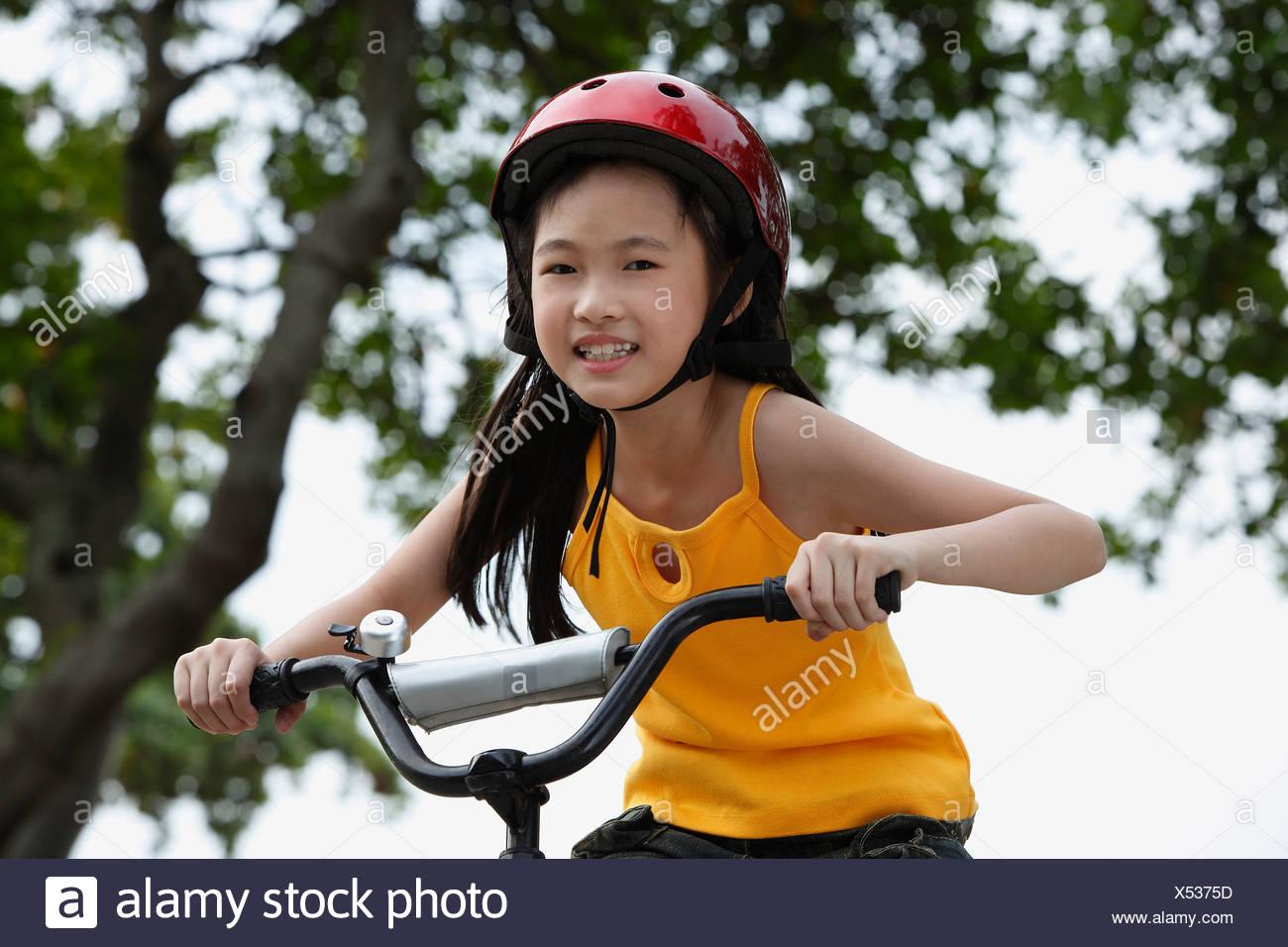 Young girl riding bike - Stock Image