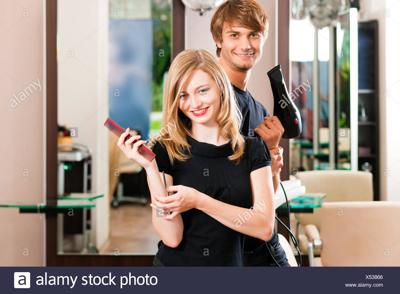 barber and hairdresser at the salon - Stock Image