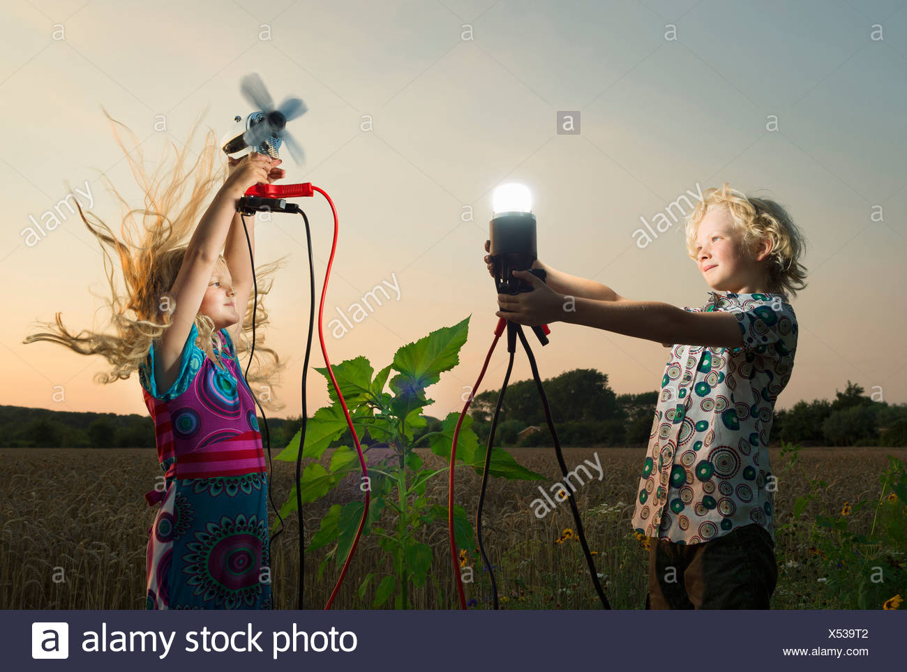 Brother and sister generating light from wind power, Zeeland, Netherlands - Stock Image