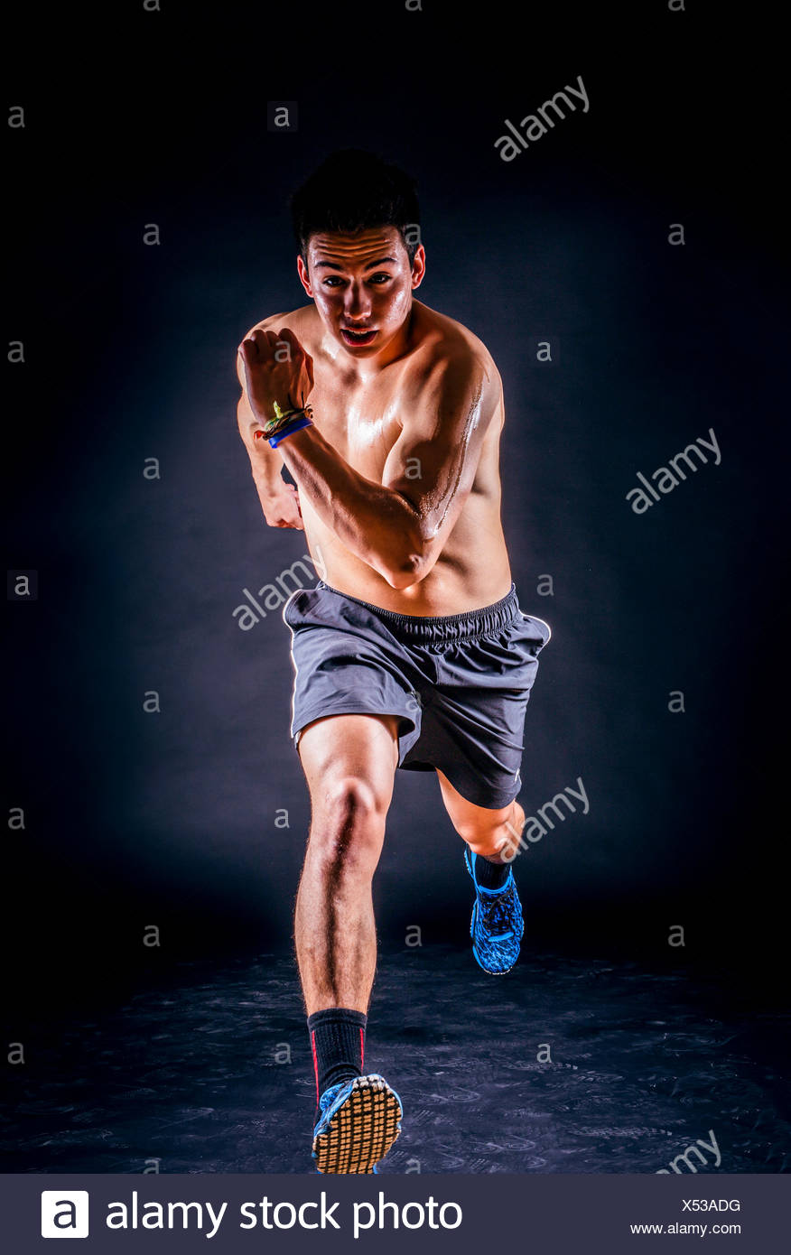 Young sportsman running - Stock Image