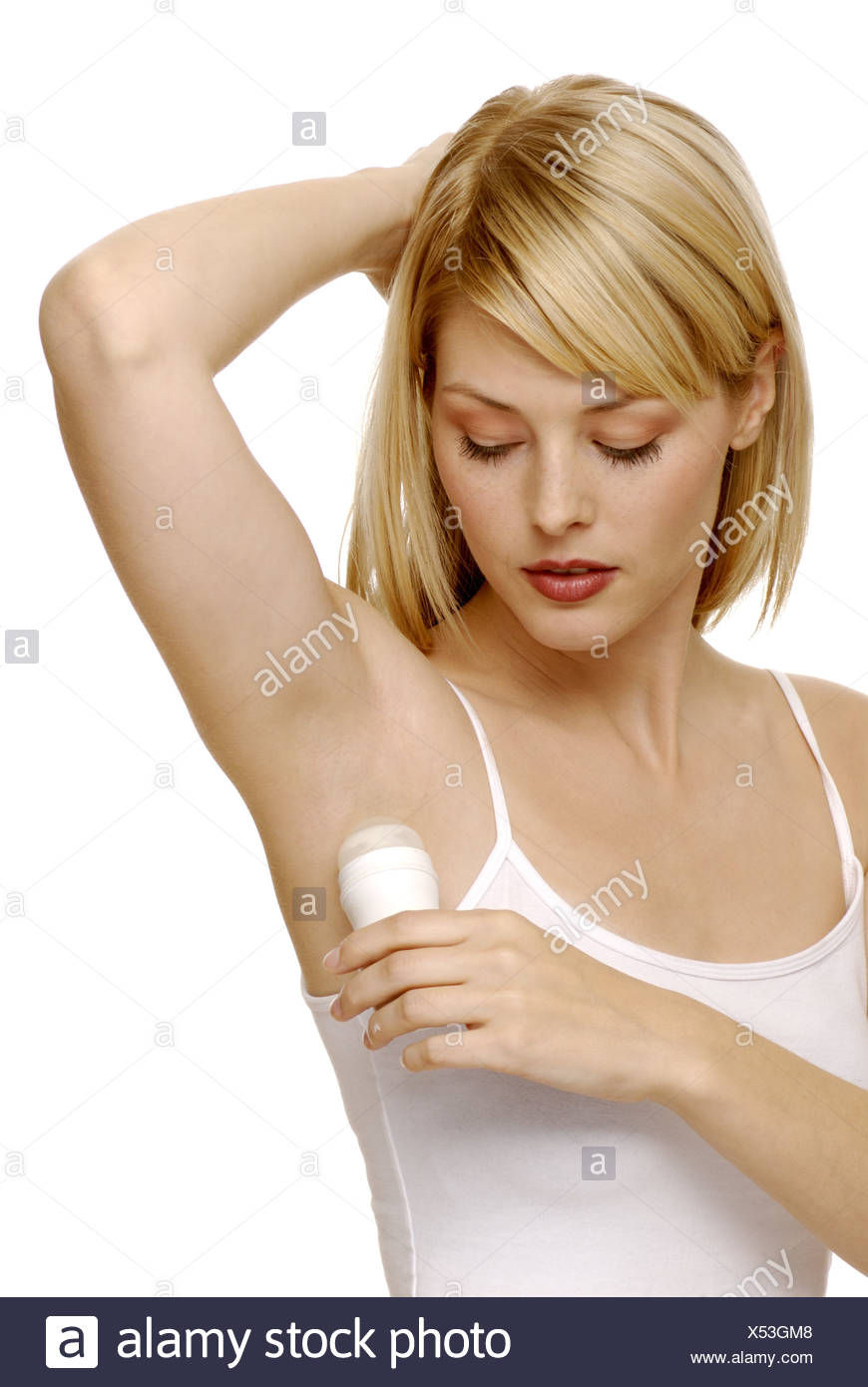 Close-up of woman using deodorant - Stock Image