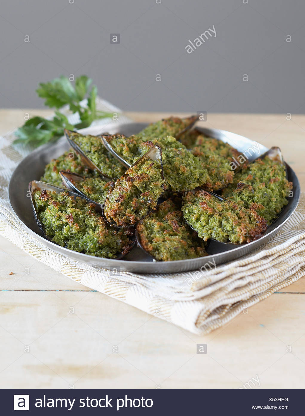 Grilled mussels with herbs - Stock Image