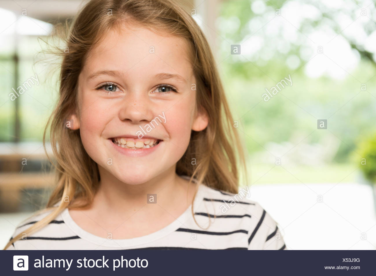 Girl with wide smile - Stock Image