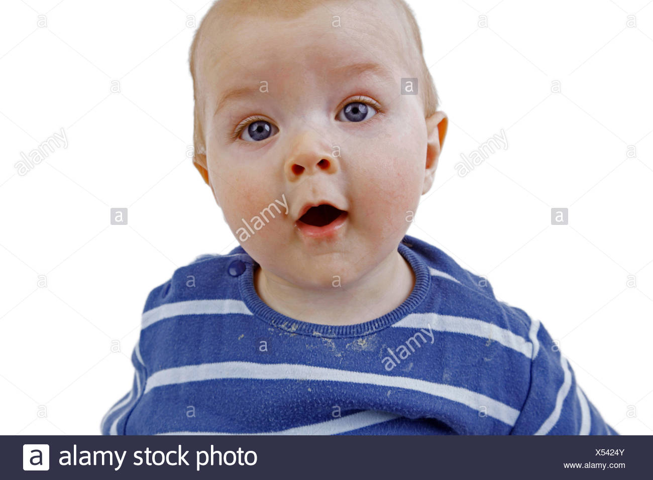 baby looking astonished at the camera - Stock Image
