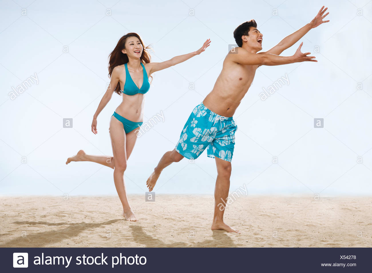 The romantic lovers hand grasping gestures on the beach - Stock Image