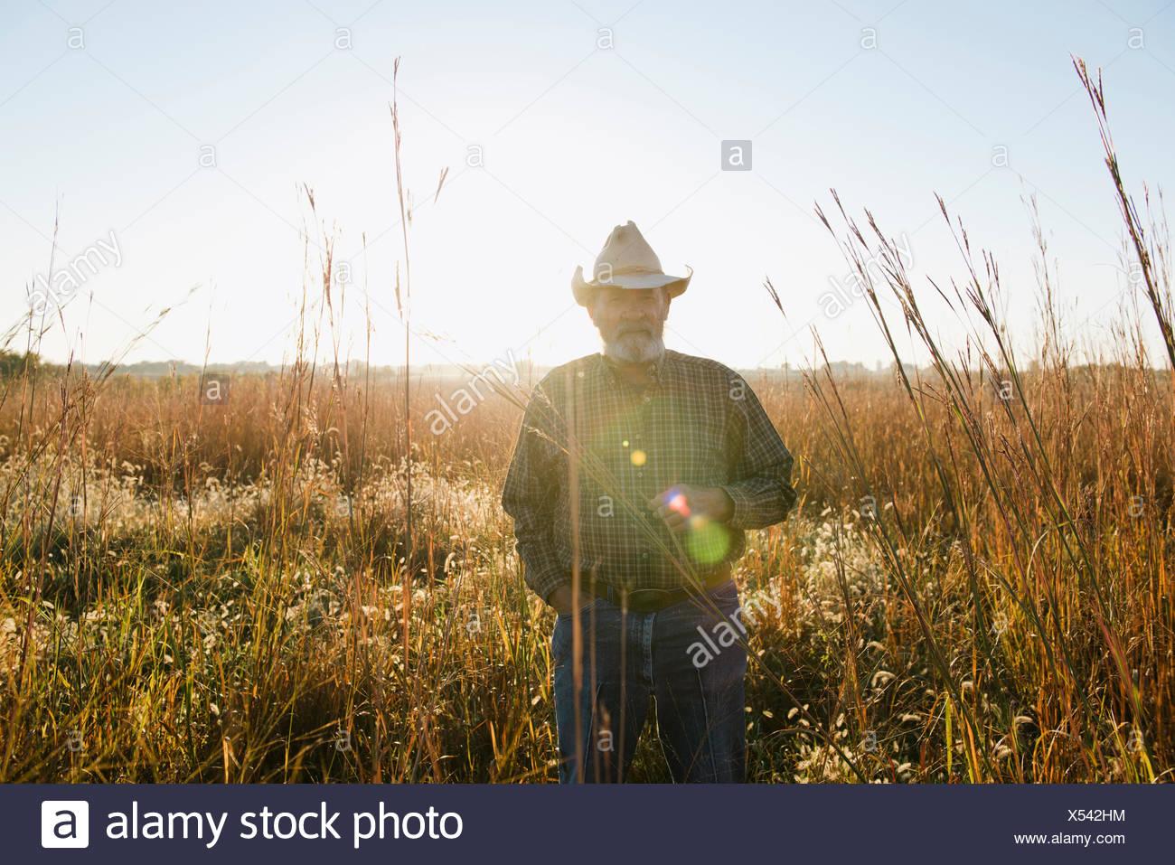 Portrait of senior male farmer in remote field, Plattsburg, Missouri, USA - Stock Image