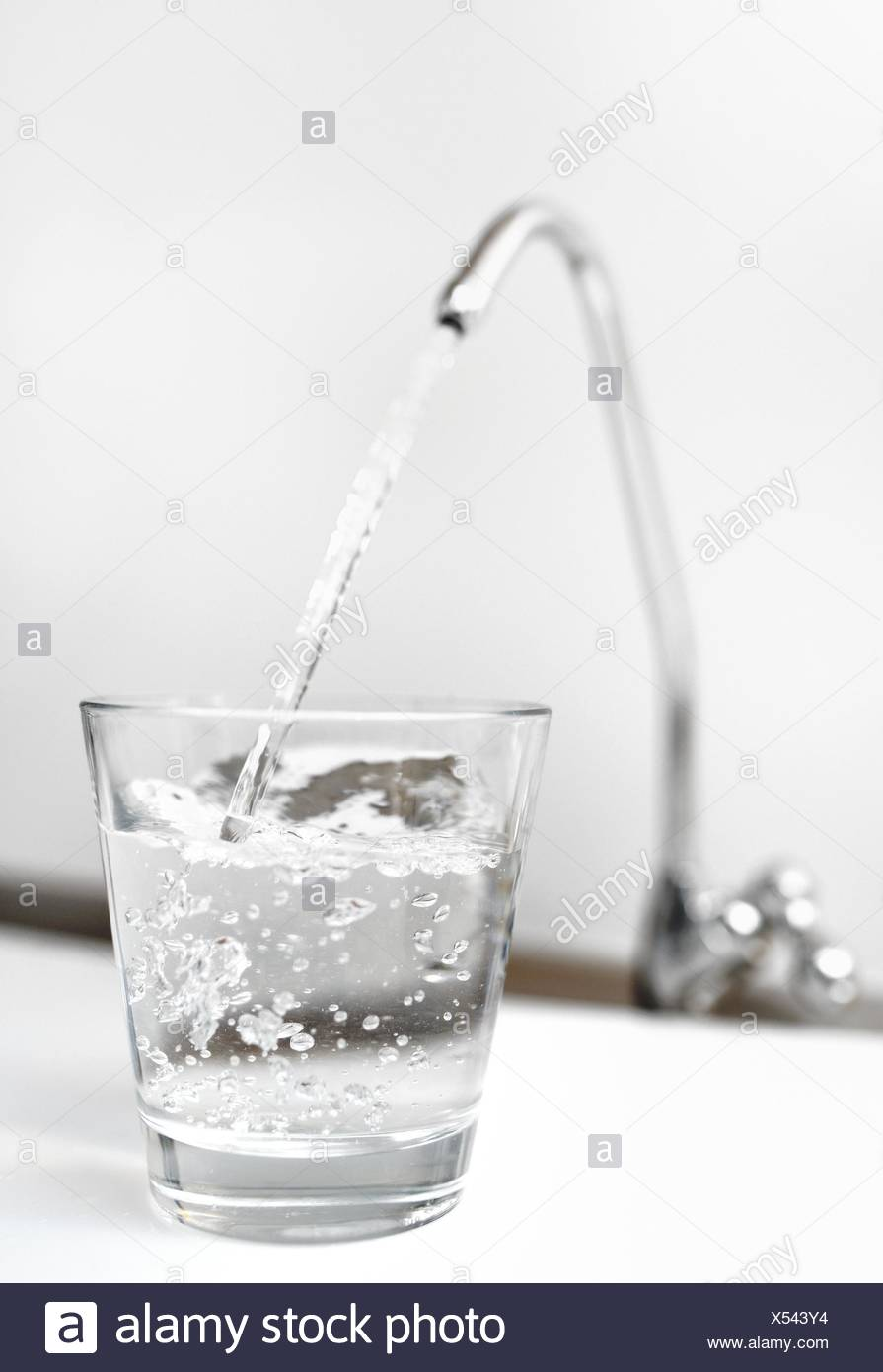 A glass of water from filter tap. - Stock Image