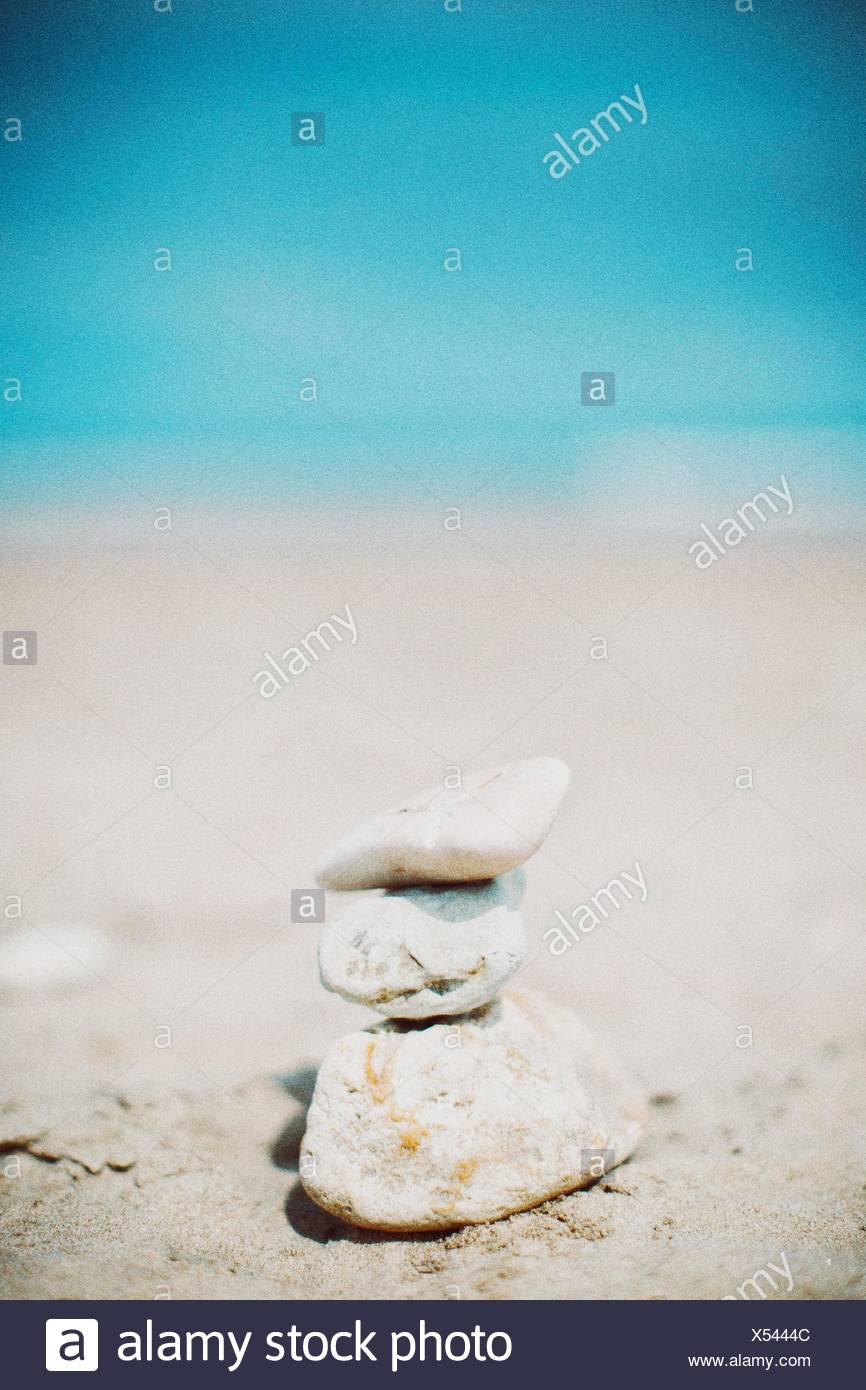 Stack Of Stones On Beach - Stock Image