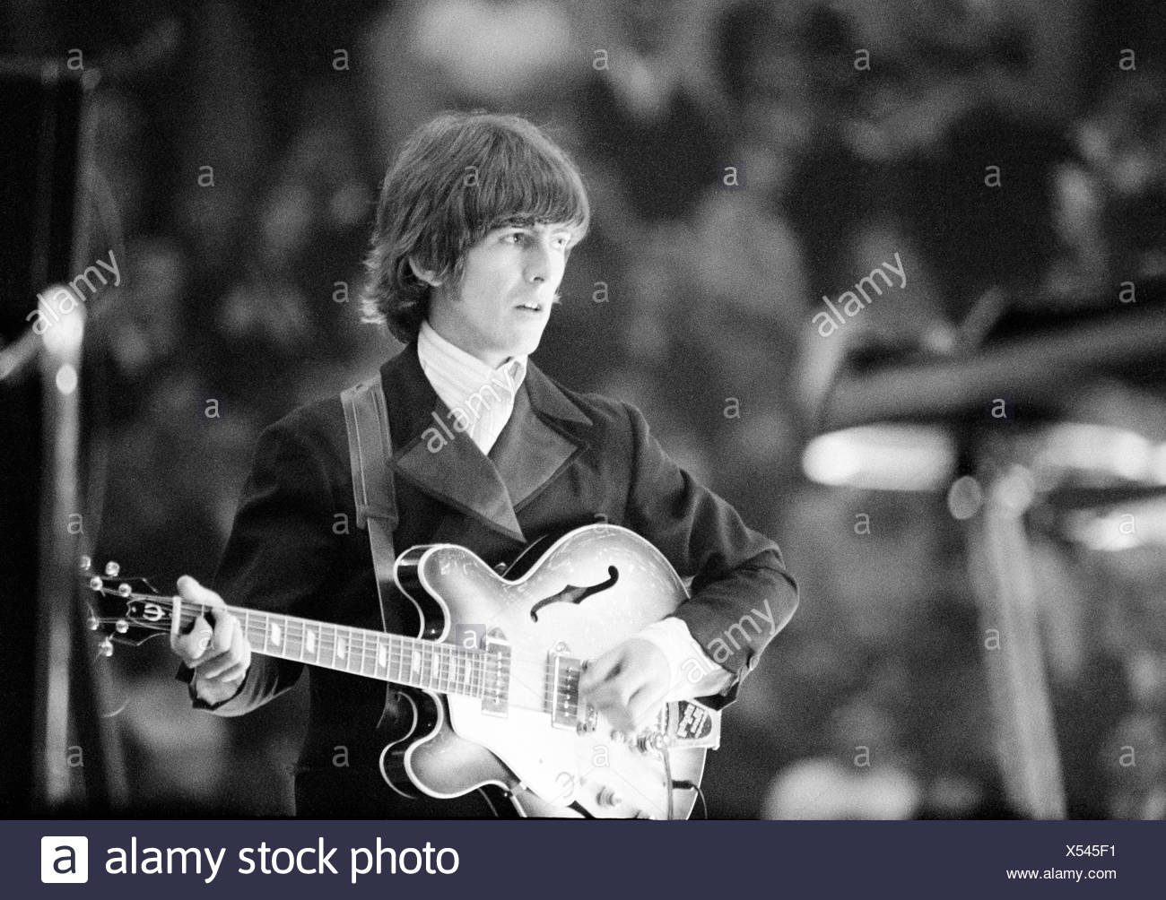 The Beatles music pop group band concert Germany Essen 1966 George Harrison guitar guitarist Stock Photo